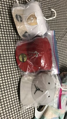 three white and red embroidred snapbacks