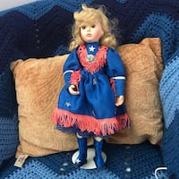 girl wearing blue and pink dress doll Rockville, 20853