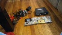 black Nintendo 64 console with controllers and game cartridges North Little Rock, 72118