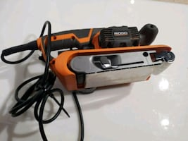 orange and black corded power tool