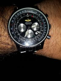 round black chronograph watch with black strap