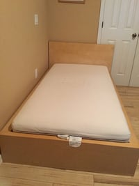 white and brown wooden bed frame Wesley Chapel, 33543
