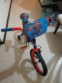 toddler's red and blue bicycle with training wheels