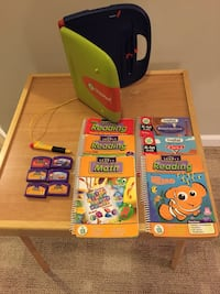 Leap Frog Read & Write Pad and 6 books and cartridges, plus 3 books. Woodbridge, 22191