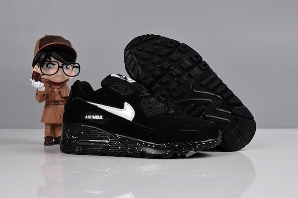 pair of black Nike Air Max shoes