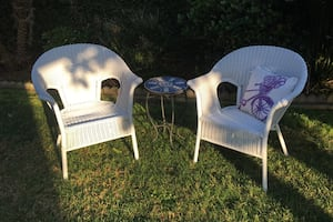 Wicker chairs, pillow and mosaic table