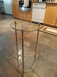 round glass top table with brown wooden base Toronto, M8W 1W9