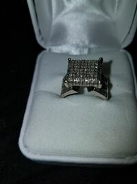 silver-colored diamond ring with box