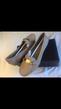 pair of brown leather loafers with box