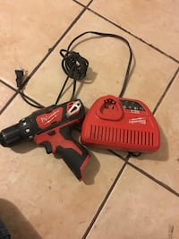 Red and black milwaukee corded hand drill