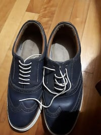 pair of black leather wing-tip dress shoes