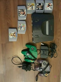 black Nintendo 64 console with controllers and game cartridges Niagara Falls, L2J 1S4