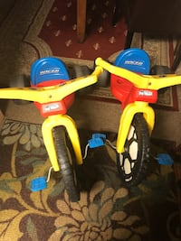 toddler's yellow and blue trike 28 km