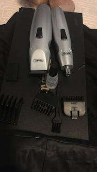 two grey Wahl hair clippers