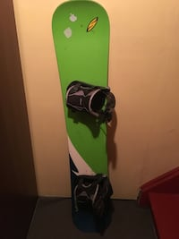 Older Lamar snowboard with flow bindings