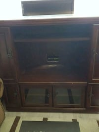 brown wooden TV hutch with flat screen television Brampton, L6X 2P2