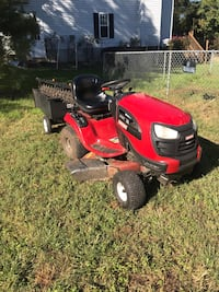 red and black riding mower Bolivar, 25425