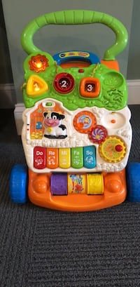 baby's yellow and red Vtech learning walker