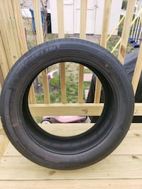 black car tire with tire Hanover, 21076