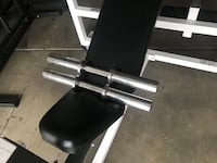 2 Solid Olympic dumbbell handles. $35