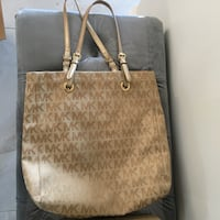 Brown michael kors leather tote bag and wallet  Montréal, H1E 4R1