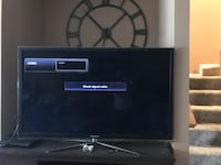 Black flat screen tv with remote Frederick, 21703