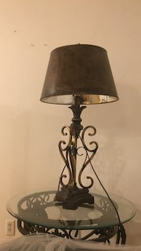 black metal base table lamp with brown empire lampshade