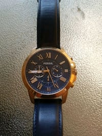 round gold-colored chronograph watch with black le Guelph, N1H 8L4
