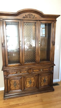 brown wooden framed glass display cabinet Wethersfield