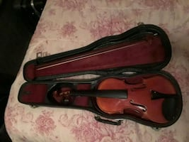 brown violin with black hard case
