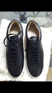 Pair of navy designer leather sneakers Montréal, H1K 0C8