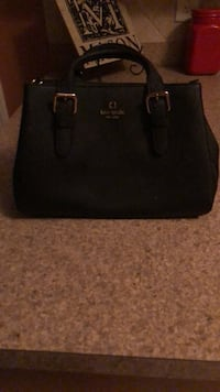 Black Kate Spade medium sized bag, only used once, practically new, no scratches, perfect for the up coming Fall/Winter season. Full retail price was $200.00 purchased last January Jefferson, 30549