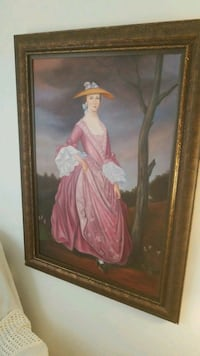 woman in red dress painting with brown wooden frame Montreal, H3R 3L4