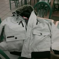 white and black zip-up jacket 509 km