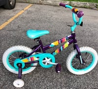 toddler's blue and pink bicycle with training wheels null