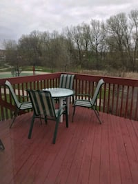 4 patio chairs + glass table top. Markham