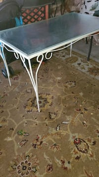 Metal table with glass top and 4 chairs see pics please Henderson, 89015
