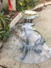 2 iron patio tables with beveled glass tops