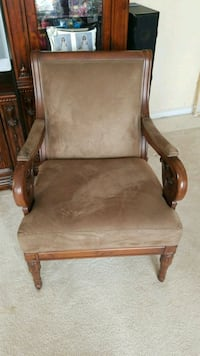 brown wooden framed brown padded armchair Chantilly, 20152