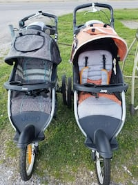 two baby's gray and black Jeep jogging strollers Collinsville, 62234