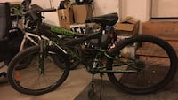 black and green full-suspension mountain bike