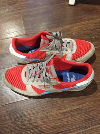 pair of red-and-white Nike running shoes Toronto, M9A 1G8