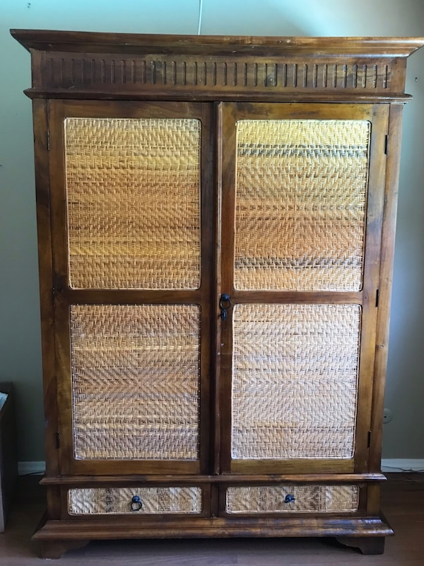Tall Indonesian teak and rattan cabinet