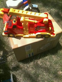 red and yellow fire engine toy truck . $10