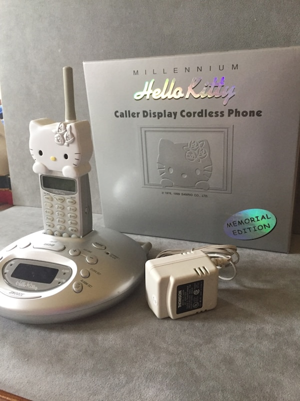 """Gray Hello Kitty wireless telephone  """"Reserved for Suzy B"""", pending pick up 7a602a82-be6e-4b8e-a1d4-eab9eebd1d8a"""