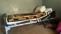 white, black, and brown hospital bed frame