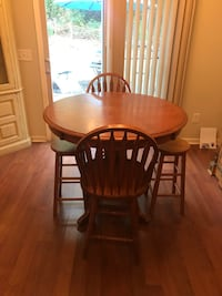 2 stools 2 chairs wooden round table. Very good condition  Woodstock, 30189