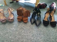 four pairs of brown and black sandals Edmonton, T5B 2W3