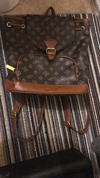 Brown and black louis vuitton leather crossbody bag No damages no less than 430  London, N5V 1A6