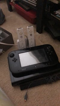 Black nintendo wii console with controllers plus 3 games Falls Church, 22046
